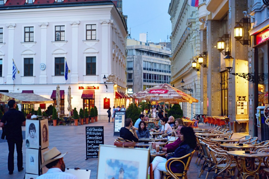 Bratislava, Slovakia - August 31, 2013: Tourists are chilling in cafe on Main Square in city downtown in Bratislava. Recently the biggest in slovakia internatioanl cha-cha contest took place here, on Main Square.