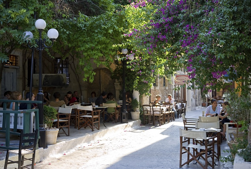 Crete, Greece - June 14, 2006: An open air restaurant with young tourists in the country center of Rethimno.