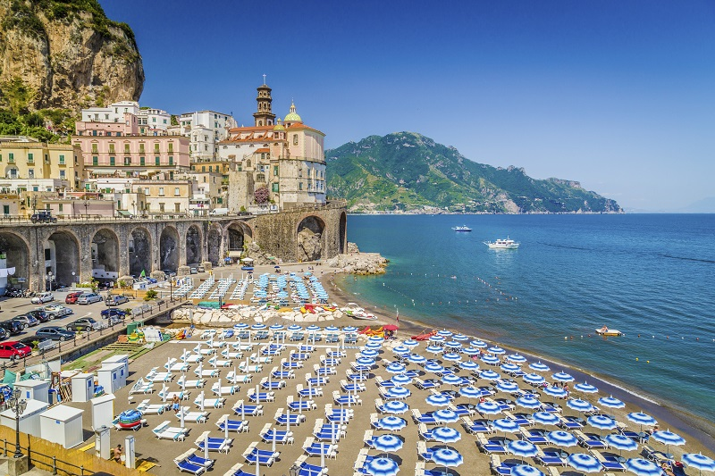 Scenic picture-postcard view of the beautiful town of Atrani at famous Amalfi Coast with Gulf of Salerno, Campania, Italy.