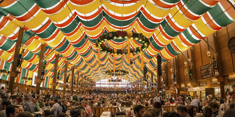 Munich, Germany- October 2, 2014: People drinking in the Loewenbrau Beer Tent on the Theresienwiese Oktoberfest fair grounds
