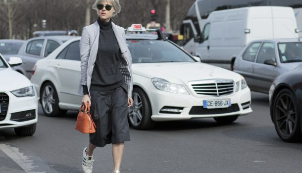 Paris, France - March 7, 2015: Fashion Blogger Linda Tol wears Louis Vuitton bag, LK Bennett jacket, Dries Van Noten trousers, Uniqlo sweater, Adidas shoes, and Mykita sunglasses on day 5 of Paris Collections.