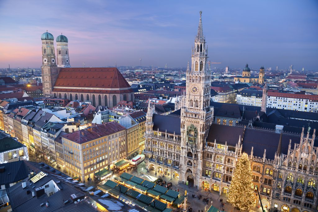 Aerial image of Munich, Germany with Christmas Market and Christmas decoration during sunset.